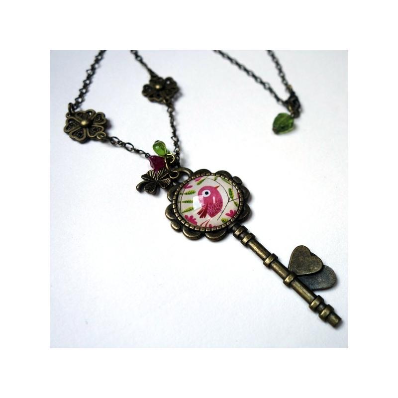 Collier clé Bel oiseau rose