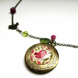 Collier secret Le bel oiseau rose