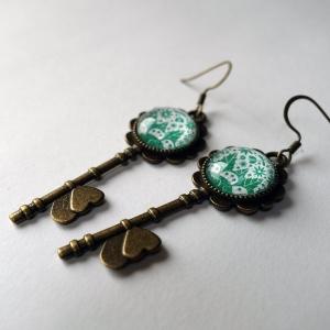 Boucles d'oreilles clés Les fleurs émeraude